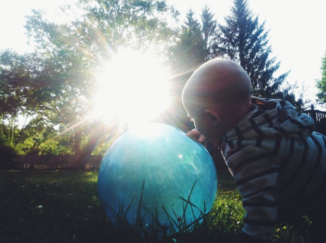 Baby with ball of light
