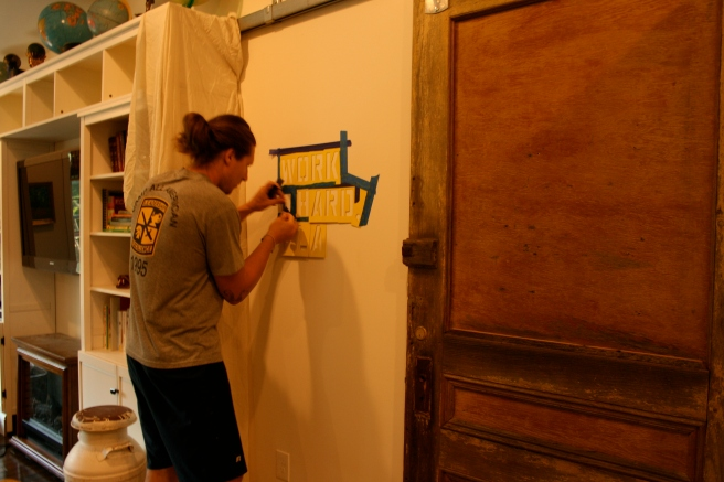 Matt had the brilliant idea to use stencil letters to put one of his favorite family phrases on the wall, and still allow the door to slide open and close.